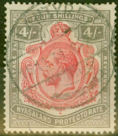 Rare Postage Stamp from Nyasaland 1927 4s Carmine & Black SG111f Damaged Leaf Bottom Right V.F.U