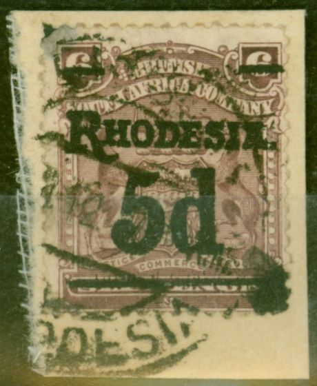 Valuable Postage Stamp from Rhodesia 1909 5d on 6d Dull Purple SG114c Fine Used on Small Piece