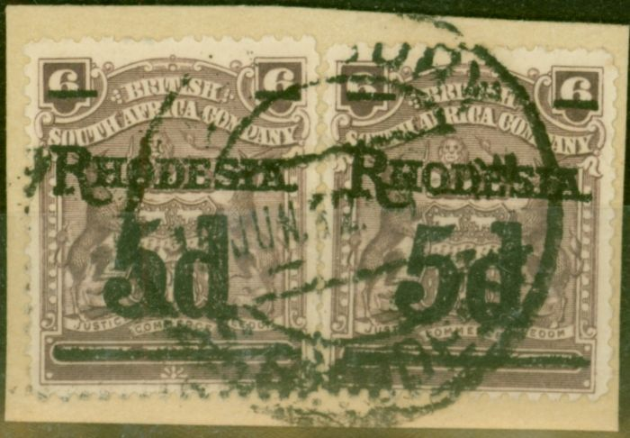 Valuable Postage Stamp from Rhodesia 1909 5d on 6d Dull Purple SG114c x 2 Fine Used on Small Piece